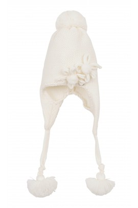 Biała czapka z pomponami, Aletta
